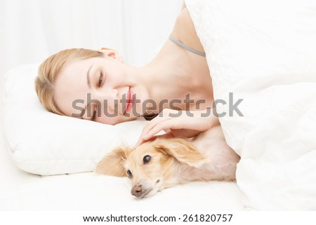 Young caucasian woman with dog - stock photo