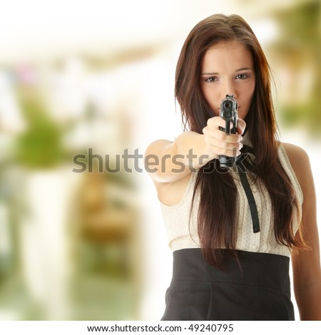 Young caucasian woman with hand gun - stock photo