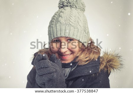 Young caucasian woman with hat and gloves in winter - stock photo
