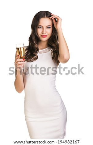 Young celebrating woman in white dress . Beautiful model portrait isolated over white background hold wine glass. - stock photo