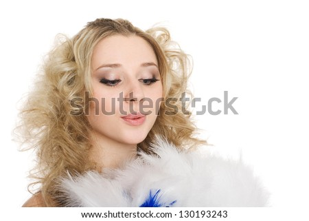Young charming blonde girl blows on the feathers of the fan. - stock photo