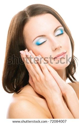 Young charming woman has closed eyes and enjoys silence, on white background. - stock photo