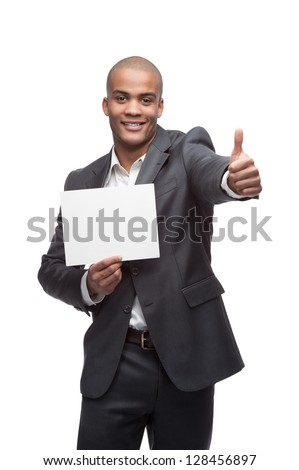 young cheerful black businessman holding sign and showing thumbs up isolated on white - stock photo