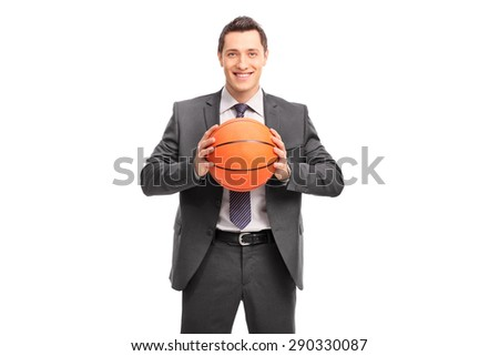 Young cheerful businessman holding a basketball and looking at the camera isolated on white background - stock photo
