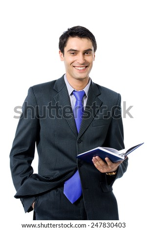 Young cheerful businessman with organizer, isolated against white background - stock photo