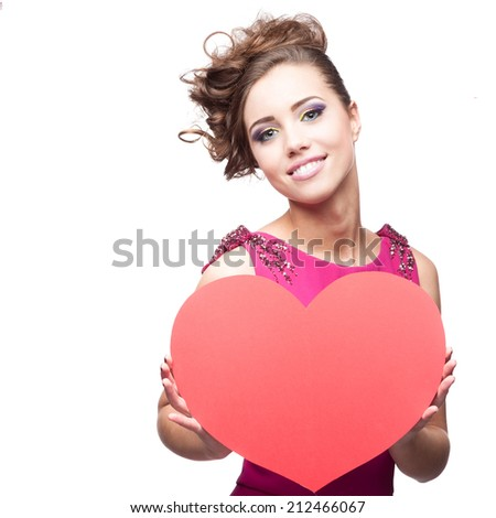 young cheerful caucasian brunette woman holding big red paper heart  isolated on white - stock photo