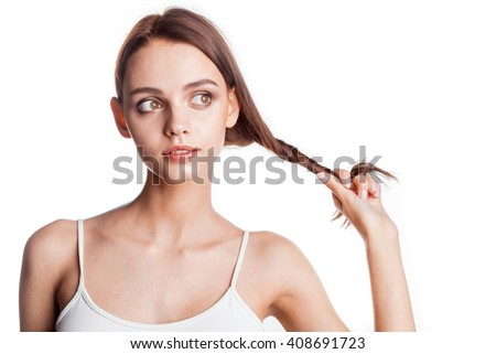 Young cheerful girl having fun. Looking away woman with bright makeup and hairstyle with pigtails. Isolated on white background.  - stock photo