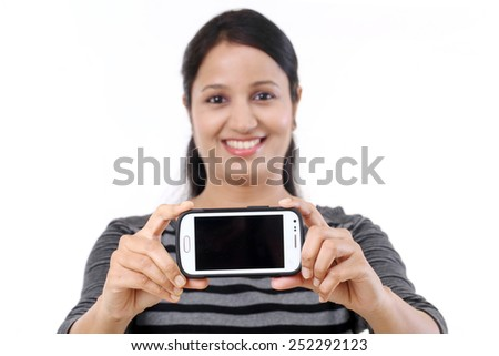 Young cheerful girl taking selfie against white - stock photo