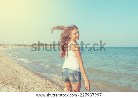 Young cheerful  happiness girl on the Bathing Beach - stock photo