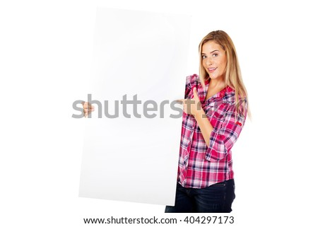 Young cheerful woman holding empty banner - stock photo