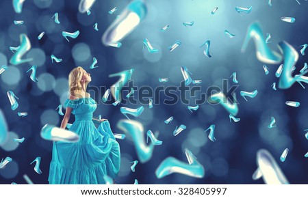 Young cheerful woman in blue dress and many falling shoes - stock photo