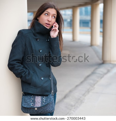 Young cheerful woman talking on the phone. - stock photo