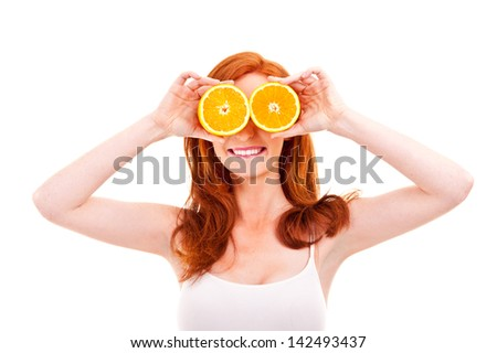 Young cheerful woman with oranges in her hands - stock photo