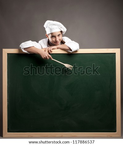 young chef holding green chalkboard - stock photo
