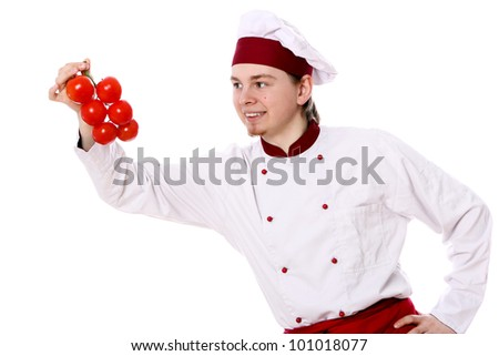 Young chef with tomatoes on white background - stock photo
