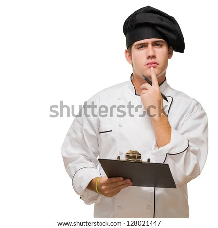 Young Chef With Writing Pad Thinking against a white background - stock photo