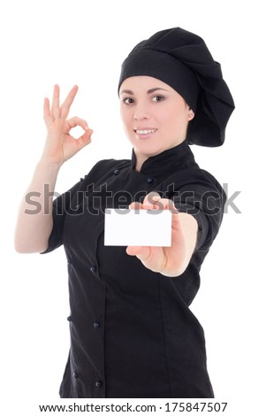 young chef woman in black uniform showing visiting card isolated on white background - stock photo