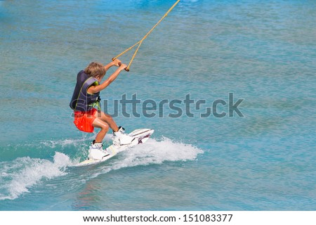 young child boy wake boarding - stock photo