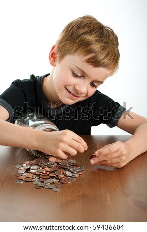 Young Child Counting Money from Glass Jar - stock photo