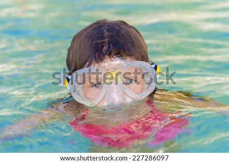 young child girl snorkelling in mask  - stock photo