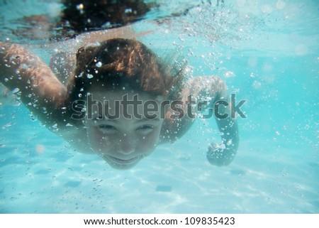 young child girl underwater - stock photo