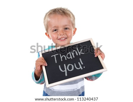 Young child holding thank you sign standing against white background - stock photo