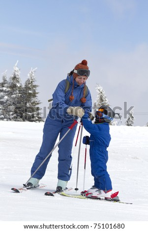 young child learning to ski - stock photo
