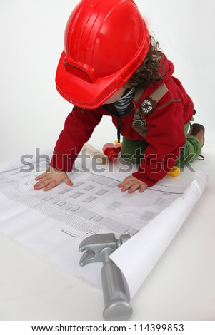 Young child pretending to be a construction worker - stock photo