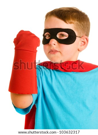 Young child pretending to be a superhero - stock photo
