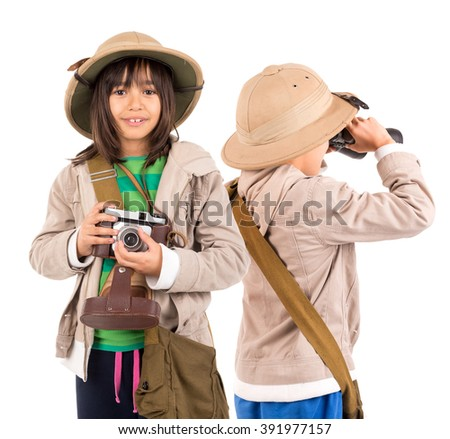 Young childen with binoculars and camera playing Safari isolated in white - stock photo