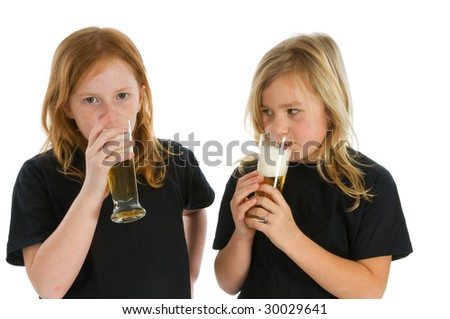 Young children are drinking alcohol - stock photo