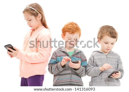 Young children using mobile phones for social media. Isolated on white. - stock photo