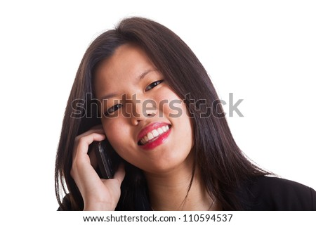 Young Chinese Woman Talking on Mobile - stock photo