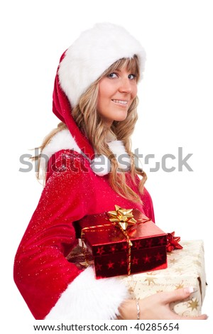 young christmas woman in red santa claus dress is holding some xmas presents - stock photo
