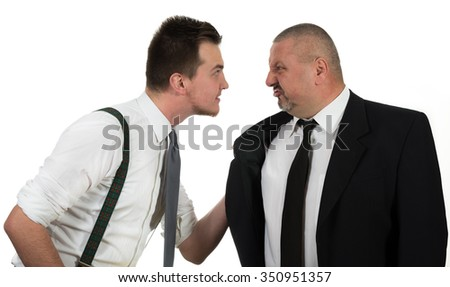 Young colleague attacking his manager - stock photo