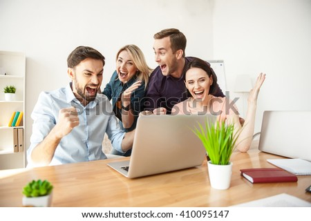 Young colleagues are happy for their success - stock photo