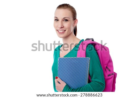 Young college girl with backpack and notebook - stock photo