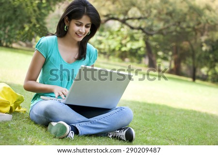 Young college student using laptop - stock photo
