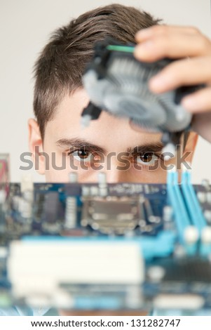 Young computer engineer. Small DOF - stock photo