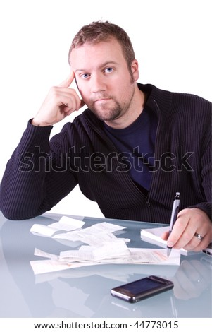 Young Concerned Casual Professional Reviewing Receipts at Work - Isolated Background - stock photo
