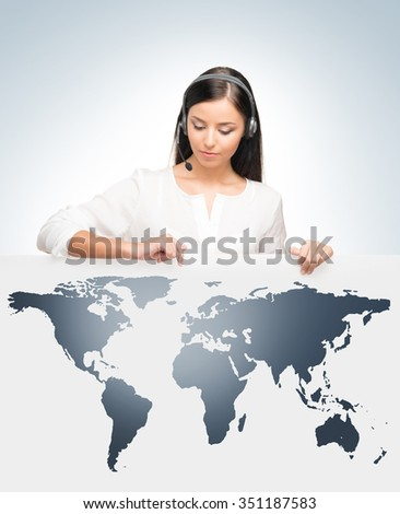 Young, confident and beautiful customer support operator. Worldwide call center concept. - stock photo