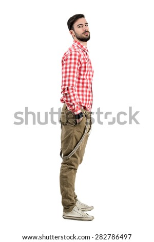 Young confident bearded hipster side view with hands in pockets. Full body length portrait isolated over white background.  - stock photo
