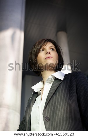 Young confident business woman looking ahead, serious look - stock photo