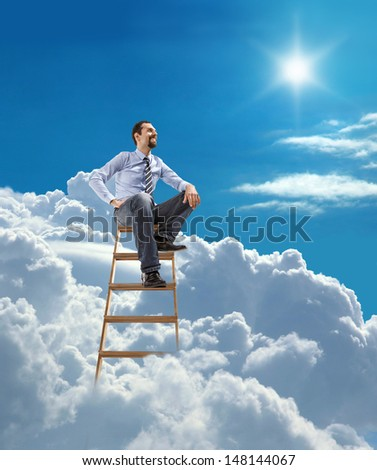 young confident businessman standing at the ladder high in the sky sits atop / young man in shirt and tie relaxing sitting on top of the ladder in heaven  - stock photo