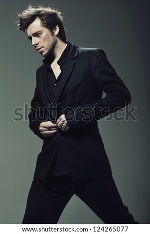 Young confident man wearing suit - stock photo