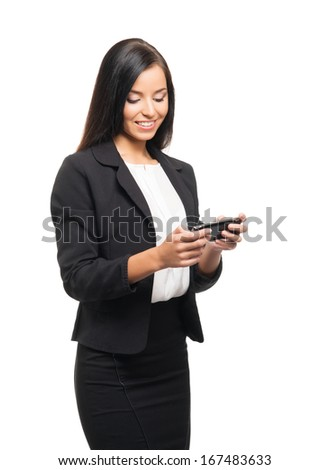 Young, confident, successful and beautiful business woman with the mobile phone isolated on white - stock photo