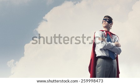 Young confident super businessman in mask and cape - stock photo