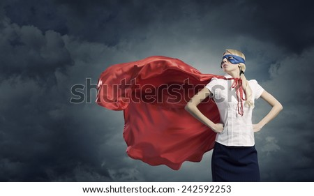 Young confident woman in super hero costume - stock photo