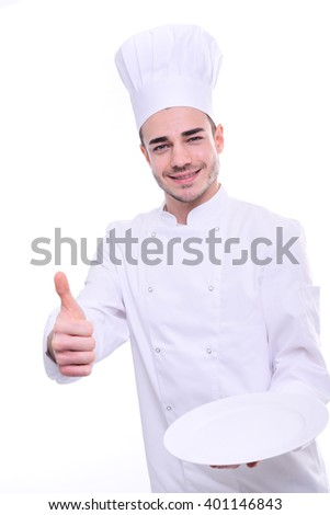 young cook chef isolated on white background holding proudly empty plate - stock photo