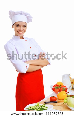 Young cook preparing food with red apron - stock photo